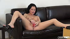 Loni sticks a pink dildo in her snatch and enjoys the pleasure it has to offer