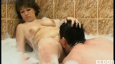 Chubby cougar gets fucked while taking a soapy bath with her son