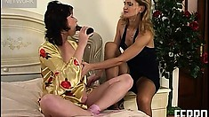Busty brunette hottie is joined by her horny girlfriend in bed
