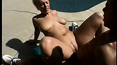 Sexy blonde MILF gets her ass fucked hard by her black pool boy