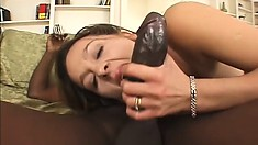 Blonde cock-tease gags while sucking a massive black jackhammer