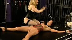 Melissa's clit gets vacuum pumped by blonde mistress Nina Hartley